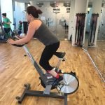 Wendie teaching spin class in a studio