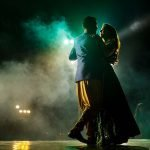 Tanvi and Saahil dancing with green lights