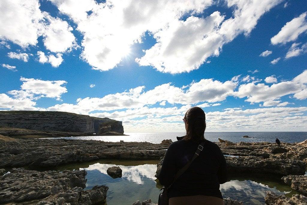 Monika looking at Fungus Rock in Gozo.