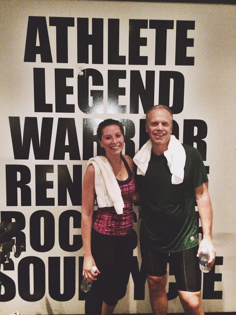 Steve Canum after teaching spin class in front of a wall with a saying Athlete, Legend