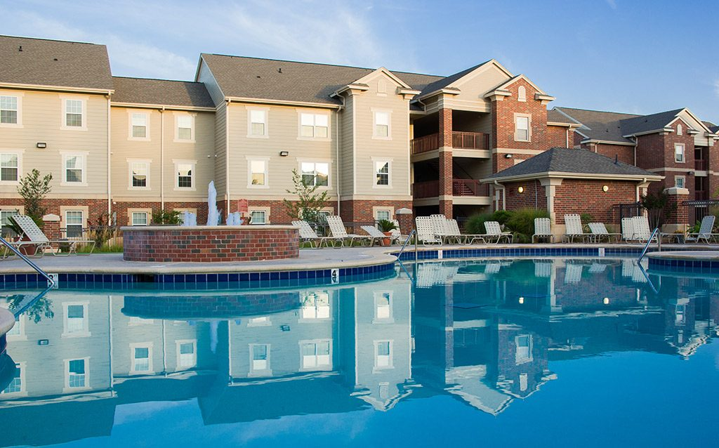 Large apartment complex with a pool.