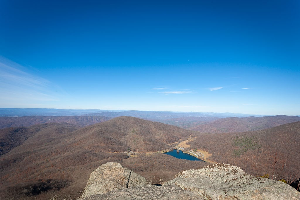 View from Sharptop Mountain, Virginia Blue Ridge Mountains overlooking a valley with blue sky