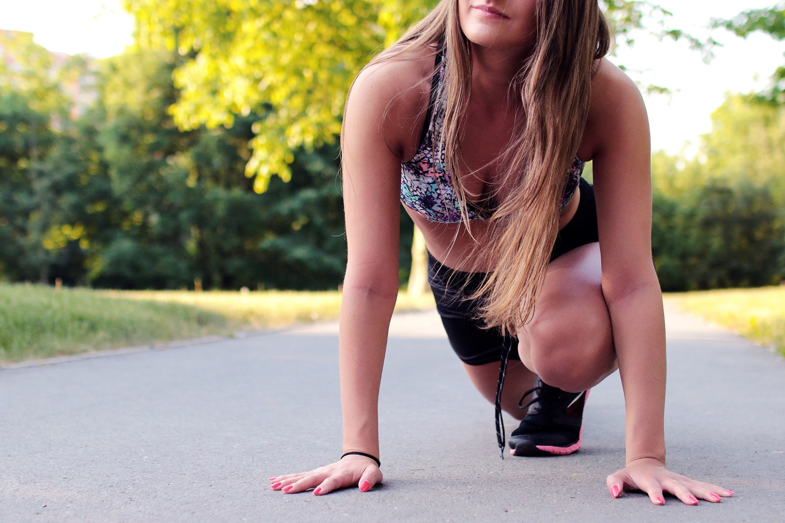 Blonde woman stretching outdoors