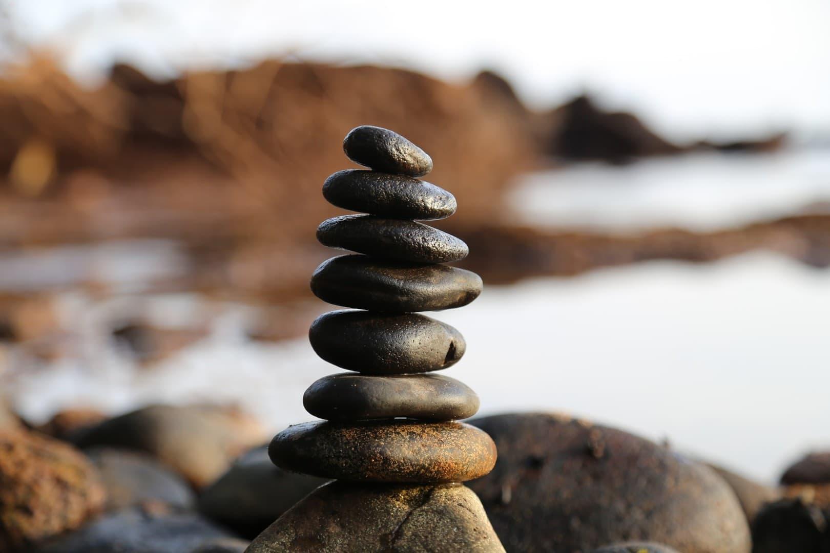 Small rocks balanced on a boulder