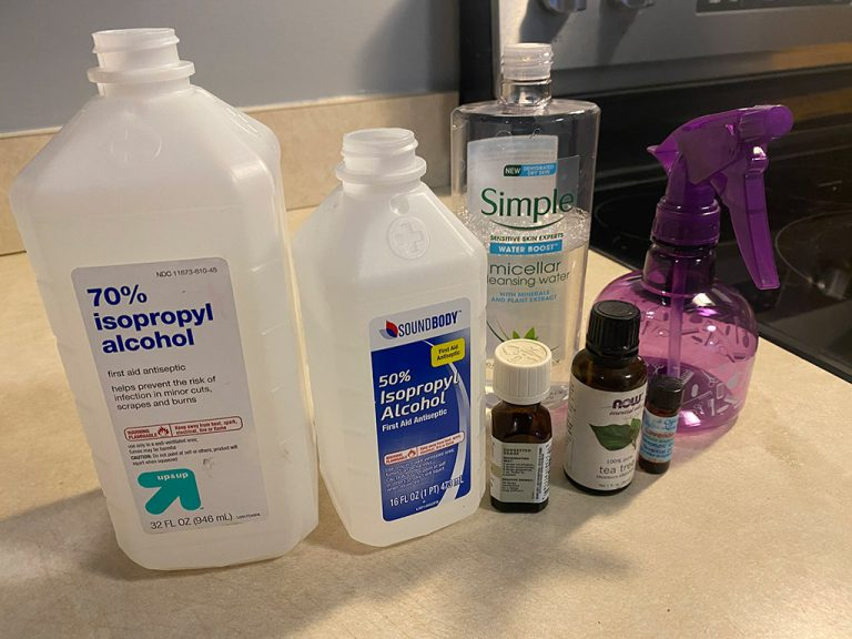 hand sanitizing spritzer ingredients on a counter- alcohol, essential oils, micellar water