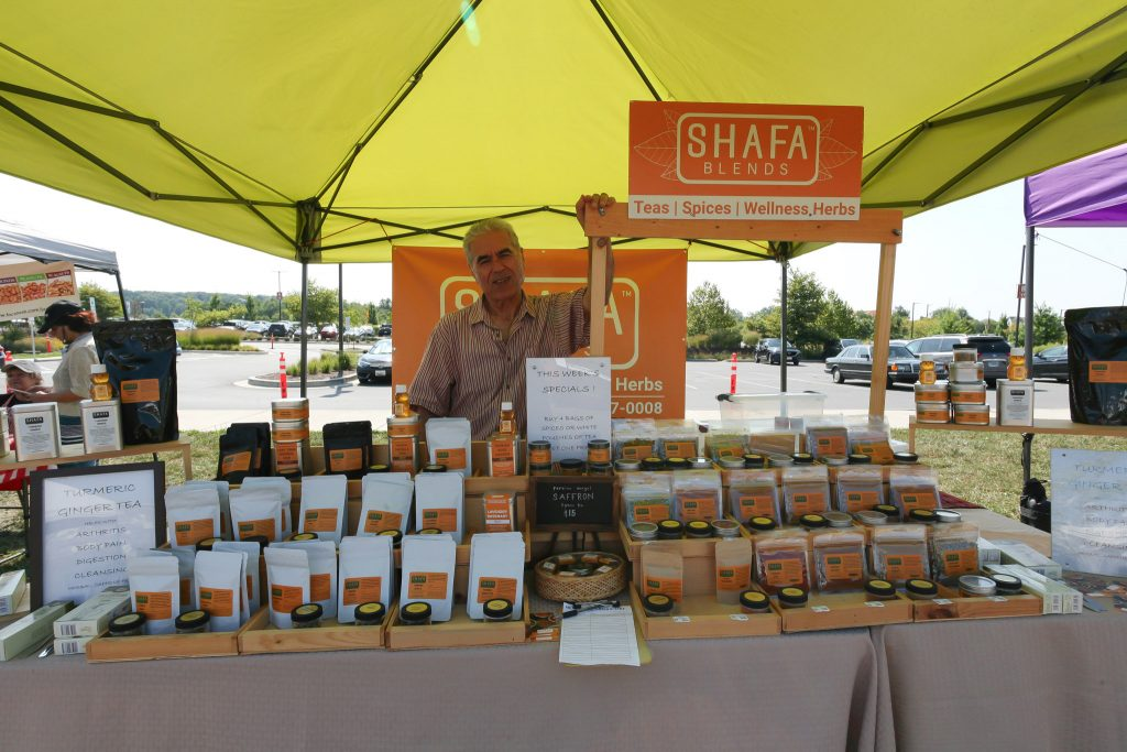 Mr. Shafa of Shafa Blends proudly displays his spices at local farmers markets across Montgomery County, Md.