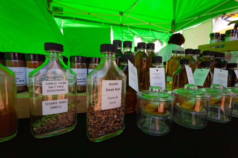 Olive Oil and spices under a green tent